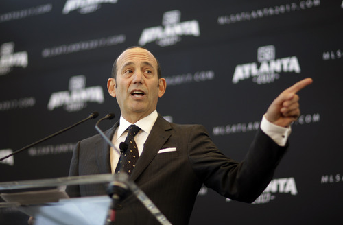 Major League Soccer Commissioner Don Garber speaks during a news conference announcing the city will be getting an MLS expansion team, Wednesday, April 16, 2014, in Atlanta. MLS announced its newest franchise Wednesday, unveiling a team for Atlanta that will begin play in 2017 at the city's new retractable roof stadium. (AP Photo/David Goldman)