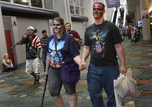 Scott Sommerdorf      The Salt Lake Tribune Shannon Johnson and Chris Hurless walk with fresh face paint during the opening day of Salt Lake Comic Con, Thursday, April 17, 2014.