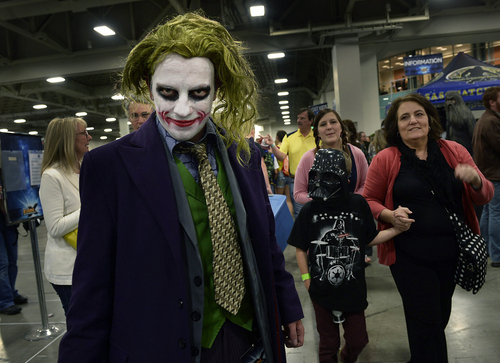 "Scott Sommerdorf      The Salt Lake Tribune Eric Morgan as ""The Joker"" poses on the floor at the opening day of Salt Lake Comic Con, Thursday, April 17, 2014."