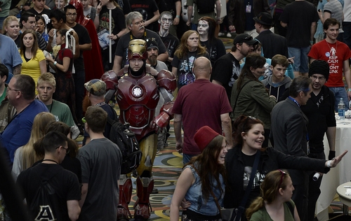 Scott Sommerdorf      The Salt Lake Tribune A man in a full Iron Man suit clanks through the hallway at the Salt Palace during the opening day of Salt Lake Comic Con, Thursday, April 17, 2014.