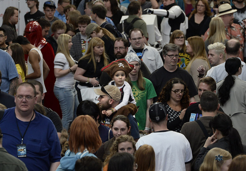 Scott Sommerdorf      The Salt Lake Tribune This little girl in a pirate hat got a birds-eye view of the craziness during the opening day of Salt Lake Comic Con, Thursday, April 17, 2014.