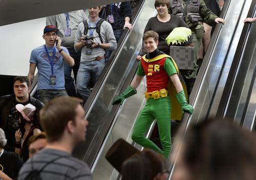 "A man in a ""Robin"" suit arrives at the opening day of Salt Lake Comic Con, Thursday, April 17, 2014, in Salt Lake City, Utah. (AP Photo/The Salt Lake Tribune, Scott Sommerdorf)"