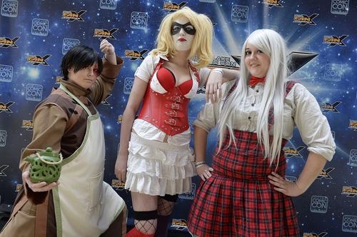 "Scott Sommerdorf      The Salt Lake Tribune ""Prussia"" (Sami Whitesides), left, ""HarleyQuinn"" (Jade Lindgren), and ""Zuko"" (Mattie Csicsery) pose for a photo at the opening day of Salt Lake Comic Con, Thursday, April 17, 2014."