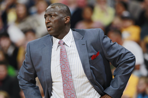 Utah Jazz head coach Tyrone Corbin directs his team against the Denver Nuggets in the first quarter of an NBA basketball game in Denver on Saturday, April 12, 2014. (AP Photo/David Zalubowski)
