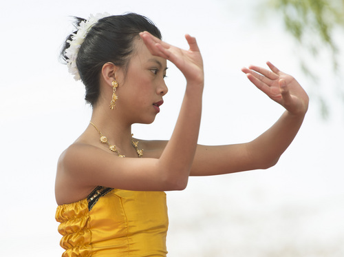 Rick Egan  |  The Salt Lake Tribune  Nadia Wongsathan, dances at the Songkran Festival at the Wat Dhammagunaram Buddhist Temple in Layton, Saturday, April 19, 2014.   The annual two day Thai-Lao New Year celebration includes authentic food and music, and the Miss Songkran beauty contest. It continues Sunday at 10 a.m. to 2 p.m, and is open to the public.