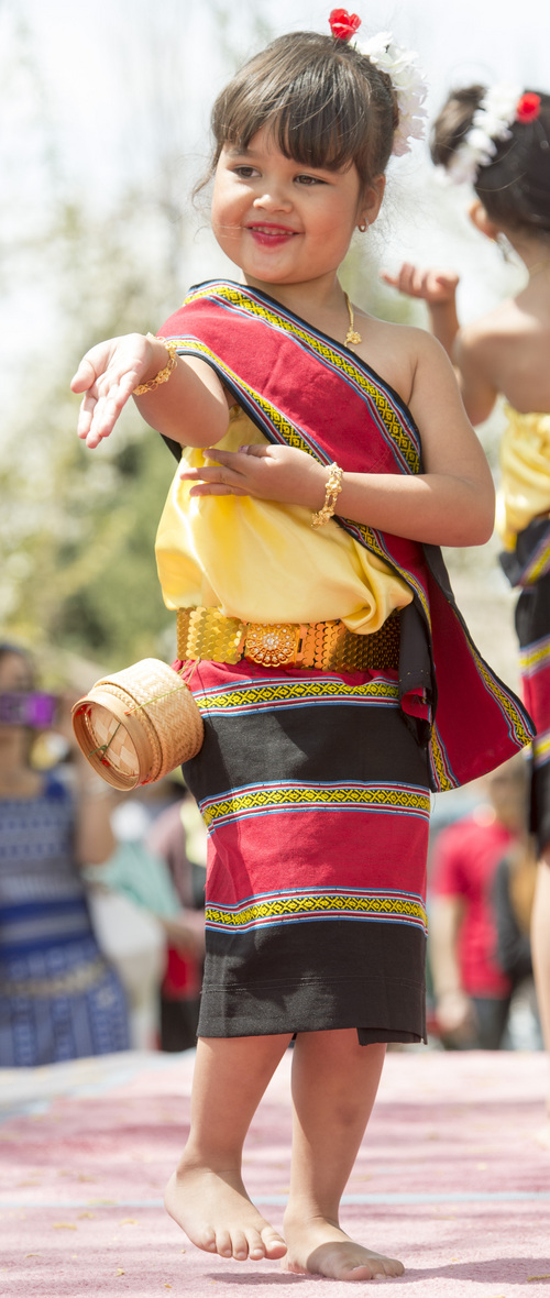 Rick Egan  |  The Salt Lake Tribune  Samantha Faulkner dances at the Songkran Festival at the Wat Dhammagunaram Buddhist Temple in Layton, Saturday, April 19, 2014.   The annual two day Thai-Lao New Year celebration includes authentic food and music, and the Miss Songkran beauty contest. It continues Sunday at 10 a.m. to 2 p.m, and is open to the public.