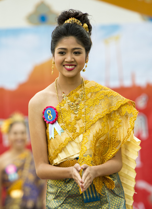 Rick Egan  |  The Salt Lake Tribune  Miss Songkran contestant, Rosita Charbsuwan, smiles at the judges, during the Miss Songkran competition at the Wat Dhammagunaram Buddhist Temple in Layton, Saturday, April 19, 2014.   The annual two day Thai-Lao New Year celebration includes authentic food and music, and the Miss Songkran beauty contest. It continues Sunday at 10 a.m. to 2 p.m, and is open to the public.