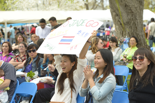 Rick Egan  |  The Salt Lake Tribune  Huilin Yang, and Yiqi Xu cheer for Miss Songkran contestant, Parada Ganrayanapoy,  at the Songkran Festival at the Wat Dhammagunaram Buddhist Temple in Layton, Saturday, April 19, 2014.   The annual two day Thai-Lao New Year celebration includes authentic food and music, and the Miss Songkran beauty contest. It continues Sunday at 10 a.m. to 2 p.m, and is open to the public.