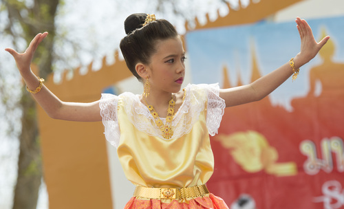 Rick Egan  |  The Salt Lake Tribune  Little dancers do the Rum Srivivhai dance at the Songkran Festival, at the Wat Dhammagunaram Buddhist Temple in Layton, Saturday, April 19, 2014.   The annual two day Thai-Lao New Year celebration includes authentic food and music, and the Miss Songkran beauty contest. It continues Sunday at 10 a.m. to 2 p.m, and is open to the public.