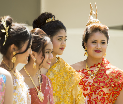 Rick Egan  |  The Salt Lake Tribune  Miss Songkran contestants left to right, Penny Churarranatham, Minta Sinpong, and Rosita Charbsuwan, and  Kantaphat Waiyapan,before the  Miss Songkran competition, at the Wat Dhammagunaram Buddhist Temple in Layton, Saturday, April 19, 2014.   The annual two day Thai-Lao New Year celebration includes authentic food and music, and the Miss Songkran beauty contest. It continues Sunday at 10 a.m. to 2 p.m, and is open to the public.