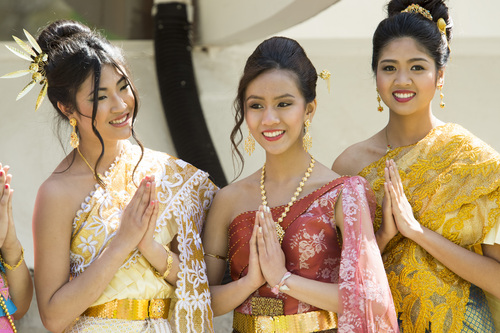 Rick Egan  |  The Salt Lake Tribune  Miss Songkran contestants left to right, Penny Churattanathan, Minta Sinpong, and Rosita Charbsuwan, before the  Miss Songkran competition, at the Wat Dhammagunaram Buddhist Temple in Layton, Saturday, April 19, 2014.   The annual two day Thai-Lao New Year celebration includes authentic food and music, and the Miss Songkran beauty contest. It continues Sunday at 10 a.m. to 2 p.m, and is open to the public.