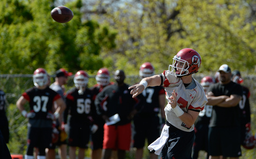 Franciso Kjolseth  |  The Salt Lake Tribune Quarterback Conner Manning hits his target as the University of Utah football team gets ready for the season during Spring practice at the Spence Eccles Football Facility on Thursday, April 17, 2014.