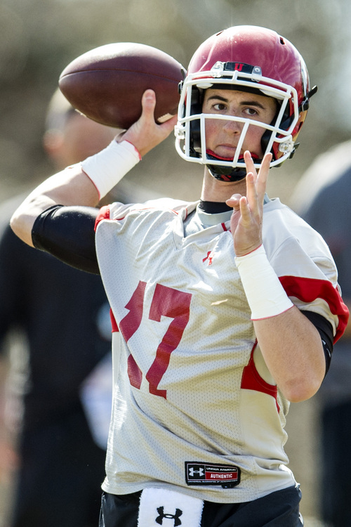 Chris Detrick  |  The Salt Lake Tribune Utah quarterback Conner Manning looks to pass the ball during a practice at Spence and Cleone Eccles Football Center Thursday March 20, 2014.