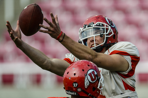 Chris Detrick  |  The Salt Lake Tribune Utah Utes quarterback Travis Wilson (7) goes after a bad snap during a scrimmage at Rice-Eccles Stadium DOW} April 12, 2014.