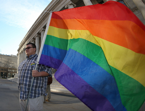 Euell Santistevan of Denver holds a rainbow flag during a protest outside the Federal Courthouse in downtown Denver on Wednesday, April 9, 2014. The protest, sponsored by Support Marriage Equality in Colorado, was held as a federal appeals court weighs inside the Denver courthouse whether to give an important victory to gay couples' right to marry in Utah and Oklahoma. (AP Photo/David Zalubowski)