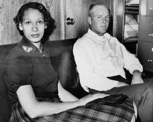 Richard P. Loving and his wife, Mildred, pose in this Jan. 26, 1965, file photograph. Residents of Caroline County, Virginia, the Lovings married in Washington, D.C., in 1958. Upon their return to Virginia, the interracial couple was convicted under the state's law that banned mixed marriages. They eventually won a U.S. Supreme Court decision in June 1967 that overturned laws prohibiting interracial unions. (AP Photo)