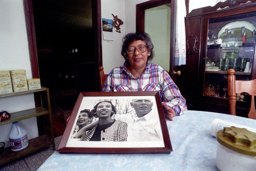 Mildred Loving of Caroline County, VA holds an older photo of her an her husband Richard. The Lovings were thrust into the national spotlight when it took a 1967 ruling by the Supreme Court to overturn a law that made Loving's interracial marriage to her caucasian husband illegal. 1992 photo taken by Robert A. Martin/The Free Lance-Star.
