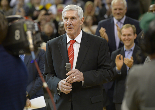 Scott Sommerdorf   |  The Salt Lake Tribune Former Jazz coach Jerry Sloan takes in the crowd's applause as he is honored at halftime of the Utah Jazz vs Golden State Warriors game, Friday, Jan. 31, 2014.