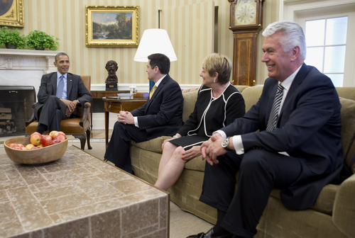 President Barack Obama meets with faith leaders, including, from second from left, Dr. Russell Moore of the Southern Baptist Convention in Nashville, Tenn., Suzii Paynter, executive coordinator, Cooperative Baptist Fellowship in Atlanta, Ga., and Dieter Uchtdorf of the Church of Jesus Christ of Latter Day Saints in  North Salt Lake City, Utah, Tuesday, April 15, 2014, in the Oval Office of the White House in Washington,. (AP Photo/Carolyn Kaster)