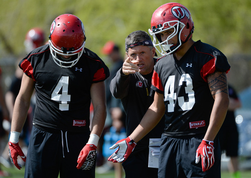 Franciso Kjolseth  |  The Salt Lake Tribune University of Utah head football coach Kyle Whittingham works with Brian Blechen, left, and Uaea Masina as he gets his team ready for the season during a Spring no pads practice at the Spence Eccles Football Facility on Thursday, April 17, 2014.