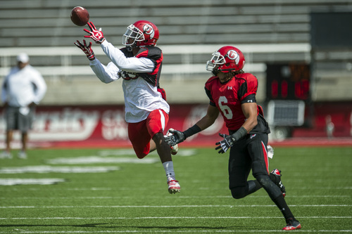 Chris Detrick  |  The Salt Lake Tribune Utah Utes defensive back Eric Rowe (18) breaks up a pass intended for Utah Utes wide receiver Dres Anderson (6) during a scrimmage at Rice-Eccles Stadium DOW} April 12, 2014.