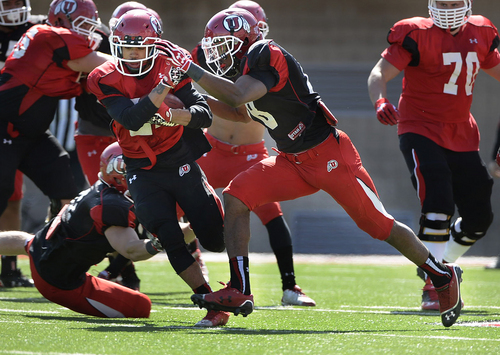 Scott Sommerdorf   |  The Salt Lake Tribune Utah CB Eric Rowe closes fast to lay a hard hit on RB Troy McCormick during Utah football practice at Rice Eccles Stadium, Saturday, March 22, 2014.
