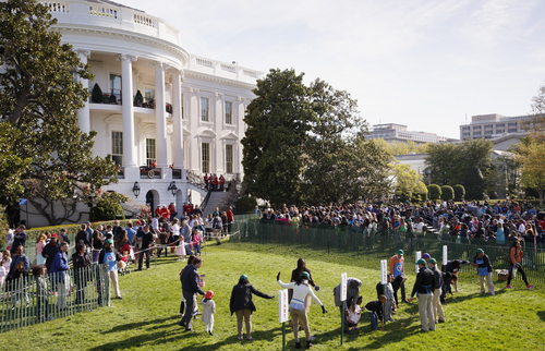 Throngs of children and parents gather on the South Lawn of the White House in Washington, Monday, April 21, 2014, for the annual White House Easter Egg Roll. Thousands of children are gathering at the White House for the annual Easter Egg Roll. President Barack Obama and first lady Michelle Obama will kick off the festivities on the White House South Lawn. This year's event features live music, cooking stations, storytelling, and of course, some Easter egg rolling.    (AP Photo/J. Scott Applewhite)