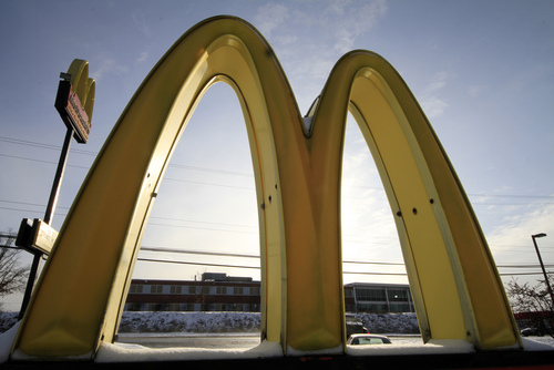FILE  - This Tuesday, Jan. 21, 2014, file photo shows McDonald's restaurant's golden arches in Robinson Township, Pa. McDonald's reports quarterly earnings on Tuesday, April 22, 2014. (AP Photo/Gene J. Puskar, File)