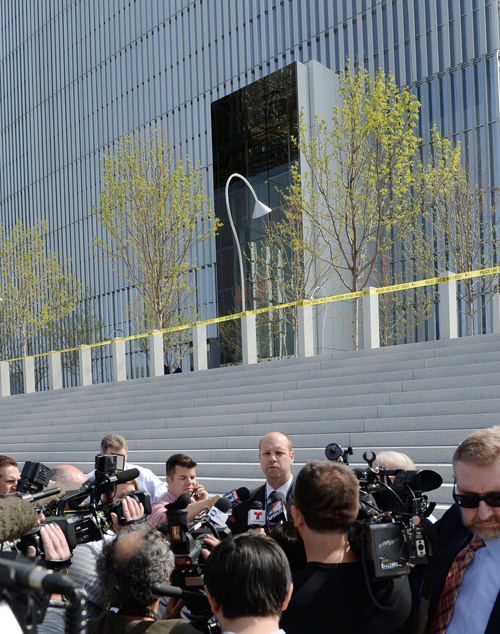Steve Griffin  |  The Salt Lake Tribune   Mark Dressen, FBI assistant special agent in charge, talks to the media outside Salt Lake Cityís new federal courthouse, after a defendant was shot inside during the first day of trial for an alleged Tongan Crip gang member Monday April 21, 2014. According to Dressen the defendant charged the witness stand with a pen or pencil, prompting a U.S. Marshal to shoot the man multiple times in the chest.