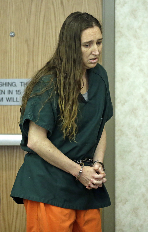 Megan Huntsman, a Utah woman accused of killing six babies she gave birth to over 10 years appears in court Monday, April 21, 2014, in Provo, Utah. Authorities say 39-year-old Huntsman told investigators that she either strangled or suffocated the six children and then put them inside boxes in her garage. (AP Photo/Rick Bowmer, Pool)