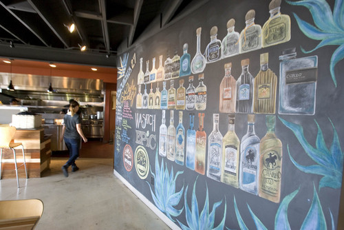 Paul Fraughton  |   The Salt Lake Tribune The colorful chalkboard wall at Taqueria 27. The grilled pear and roasted beet taco from Salt Lake City's restaurant was recognized by Food Network Magazine.