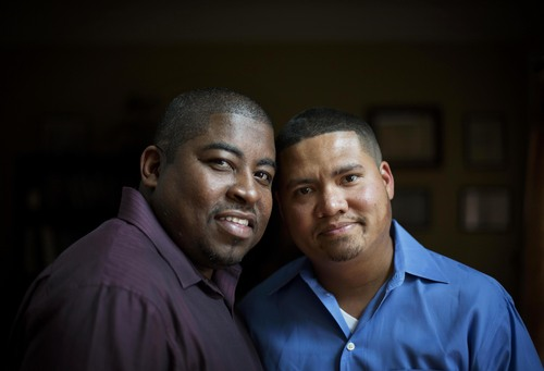 Shelton Stroman, left, and partner Christopher Inniss, are photographed in their home, Thursday, April 17, 2014, in Snellville, Ga. A gay rights group on Tuesday, April 22, 2014, filed a federal lawsuit in Atlanta challenging the state of Georgia's constitutional ban on same-sex marriages. Georgia voters in 2004 overwhelmingly approved a constitutional ban on gay marriage in 2004. The ban was challenged in courts by gay rights groups who challenged the wording of the ballot question, but the state Supreme Court ultimately ruled the vote was valid in 2006. (AP Photo/David Goldman)