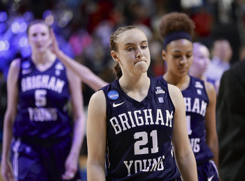 BYU's Lexi Eaton (21) walks off the court after BYU's 70-51 loss to Connecticut in a regional semifinal in the NCAA women's college basketball tournament in Lincoln, Neb., Saturday, March 29, 2014. (AP Photo/Nati Harnik)