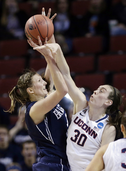 BYU's Jennifer Hamson (5) tries to shoot over Connecticut's Breanna Stewart (30) during the first half of a regional semifinal in the NCAA college basketball tournament in Lincoln, Neb., Saturday, March 29, 2014. (AP Photo/Nati Harnik)
