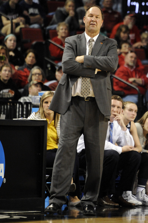 BYU coach Jeff Judkins watches from the sideline during the second half of a regional semifinal against Connecticut in the NCAA college basketball tournament Saturday, March 29, 2014, in Lincoln, Neb. Connecticut won 70-51. (AP Photo/Dave Weaver)
