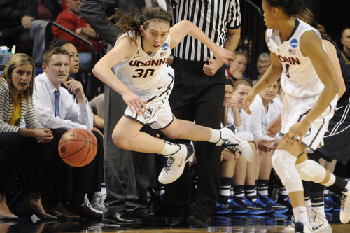Connecticut's Breanna Stewart (30) tries to keep the ball in bounds during the second half against BYU in a regional semifinal in the NCAA women's college basketball tournament Saturday, March 29, 2014, in Lincoln, Neb. Connecticut won 70-51. (AP Photo/Dave Weaver)