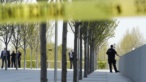Steve Griffin  |  The Salt Lake Tribune   Authorities secure the plaza at Salt Lake Cityís new federal courthouse after a defendant was shot inside Monday morning in Salt Lake City, Utah Monday, April 21, 2014.