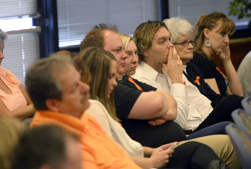 Al Hartmann  |  The Salt Lake Tribune Supporters of Shaun Cowley listen to his appeal hearing before the West Valley City Employment Commission Wednesday April 23.   Cowley was fired over shooting and killing Danielle Willard and mishandling evidence.  They wore orange clothing or an orange ribbon to show support for Cowley, who wore an orange tie.
