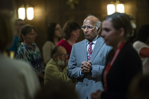 Chris Detrick  |  The Salt Lake Tribune Saman Lall waits to receive communion during the Mass of the Lord's Supper at the Cathedral of the Madeleine on Thursday, April 17, 2014.