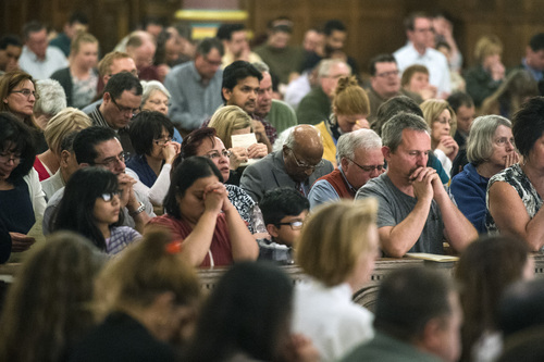 Chris Detrick  |  The Salt Lake Tribune Saman Lall prays during the Mass of the Lord's Supper at the Cathedral of the Madeleine on Thursday, April 17, 2014.