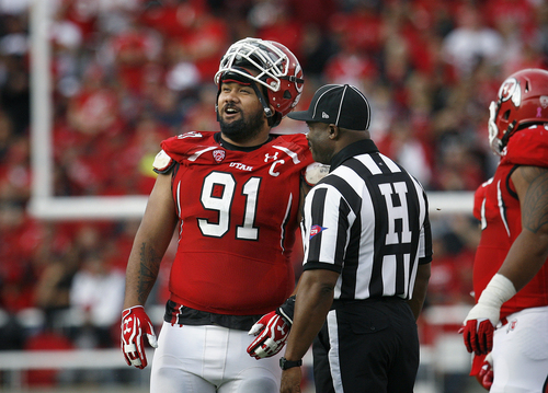 Scott Sommerdorf   |  The Salt Lake Tribune Utah Utes defensive tackle Tenny Palepoi (91) talks with Pac-12 head linesman Edwin Walker as a Stanford fumble was reviewed during first half play. Utah led Stanford 21-14 at the half, Saturday, October 12, 2013.