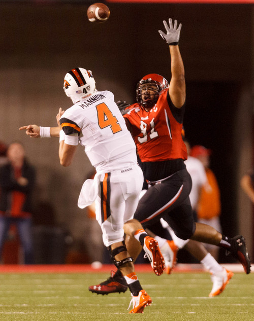 Trent Nelson  |  The Salt Lake Tribune Utah Utes defensive tackle Tenny Palepoi (91) pressures Oregon State Beavers quarterback Sean Mannion (4) as the University of Utah hosts Oregon State, college football at Rice Eccles Stadium Saturday, September 14, 2013 in Salt Lake City.