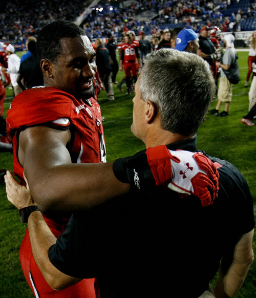Trent Nelson  |  The Salt Lake Tribune Utah Utes head coach Kyle Whittingham embraces Utah Utes wide receiver Anthony Denham (8) after the win as the BYU Cougars host the Utah Utes, college football Saturday, September 21, 2013 at LaVell Edwards Stadium in Provo.