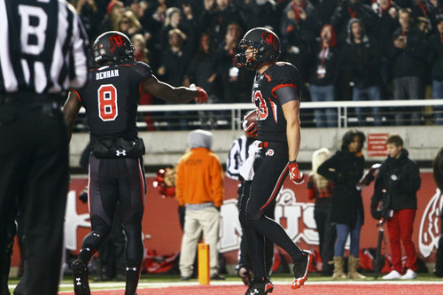 Chris Detrick  |  The Salt Lake Tribune Utah Utes wide receiver Sean Fitzgerald (83) celebrates with Utah Utes wide receiver Anthony Denham (8) after scoring a touchdown during the first half of the game at Rice-Eccles Stadium Thursday October 3, 2013. UCLA is winning the game 21-17.