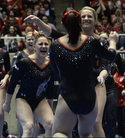 Rick Egan  | The Salt Lake Tribune   Becky Tutka and Mary Beth Lofgren  greet Corrie Lothrop, after her performance on the beam for the Utes, in gymnastics action, Utah vs. Georgia, Saturday, March 15, 2014.