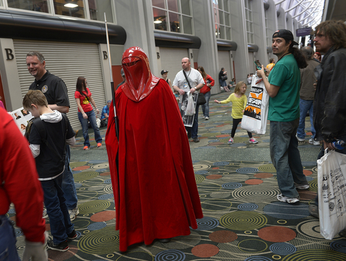 "Scott Sommerdorf   |  The Salt Lake Tribune A Star Wars ""Kanos"" character walks the halls of the Salt Palace during the opening day of Salt Lake Comic Con, Thursday, April 17, 2014."