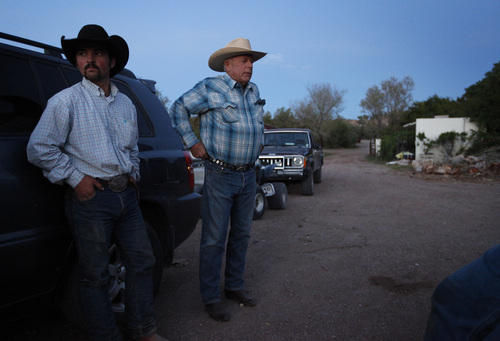 """Cliven Bundy, right, and Clance Cox, left, stand at the Bundy ranch near Bunkerville Nev. Saturday, April 5, 2014. The Bureau of Land Management has begun to round up what they call """"trespass cattle"""" that rancher Cliven Bundy has been grazing in the Gold Butte area 80 miles northeast of Las Vegas. (AP Photo/Las Vegas Review-Journal, John Locher)"""