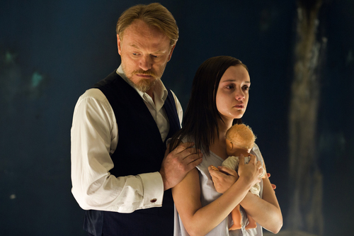 """This image released by Lionsgate shows Jared Harris, left, and Olivia Cooke in a scene from """"The Quiet Ones."""" (AP Photo/Lionsgate, Chris Harris)"""