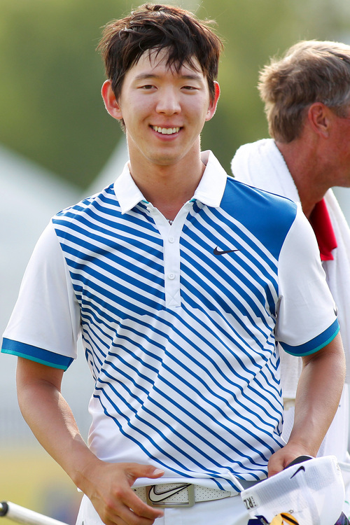 Seung-Yul Noh, of South Korean, smiles after making par on the 18th hole during the third round of the PGA Zurich Classic golf tournament at TPC Louisiana in Avondale, La., Saturday, April 26, 2014. (AP Photo/Jonathan Bachman)