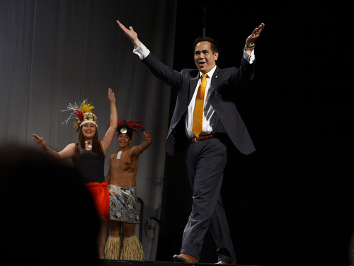 Scott Sommerdorf   |  The Salt Lake Tribune Utah Attorney General Sean Reyes dances with a dance group from American Somoa at the Western Republican Leadership Conference as they held a rally at the South Towne Convention Center, Friday, April 25, 2014.